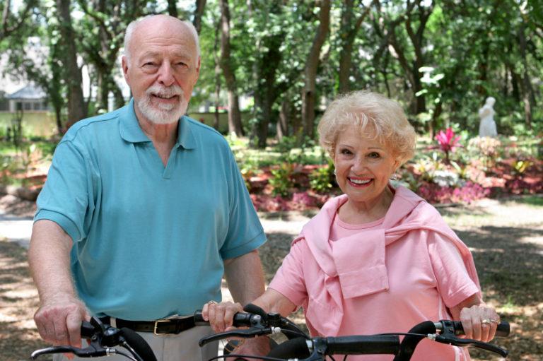 Seniors riding a bike